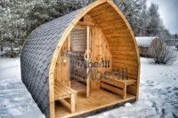 Smuk udendørs have sauna Iglu design om vinteren med panoramavindue